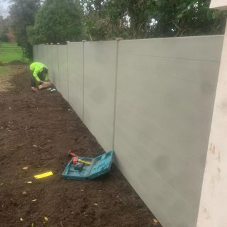 Composite fencing & steel rail fence across the back.