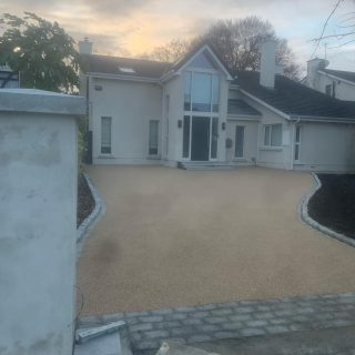 Resin bond driveway with silver granite border , new pillars and walling with granite caps and white plaster. #resinbonddriveways #greystones